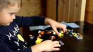 Boy playing with lego cubes video