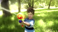 Boy playing with squirt gun video