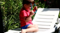 boy playing with sunglasses video