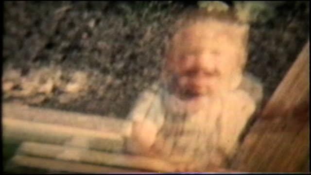 Boy Plays With Garden Hose (1963 Vintage 8mm film) video