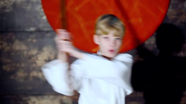 Boy Practicing Aikido Is Training With Bokken Sword video