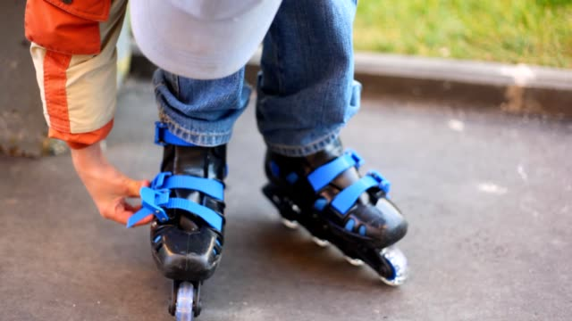 Boy puts on roller skates video