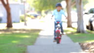 Boy Riding Bike Towards Camera video