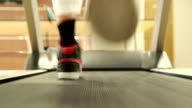 Boy running on the treadmill video