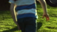Boy runs to tire swing, slow moiton video