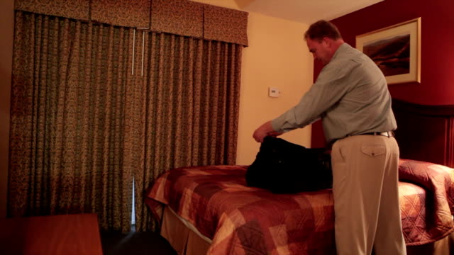 Boy Scaring Dad out of Suitcase video