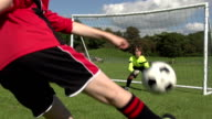 Boy scoring amazing Volley goal in Kid's Football / Soccer video