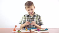 Boy sculpts from plasticine figurines video
