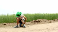boy sitting on the ground with a graze on knee filled with green paint video