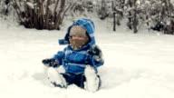 Boy sitting on the snow video