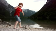 HD SLOW MOTION: Boy Skimming Stones video