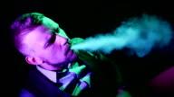 Boy smoking hookah in the lounge caffee video