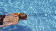 Boy snorkeling in pool, overhead shot. video