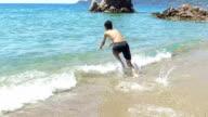 Boy swimming. Slow motion video