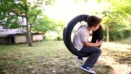 Boy swinging on a tire swing video