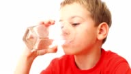 Boy takes glass, drinks all water in it video