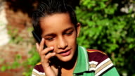 Boy talking on mobile phone video