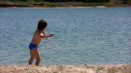 Boy throwing stone in river and runs away video