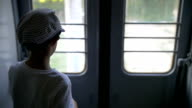 boy traveling by train, slow motion video