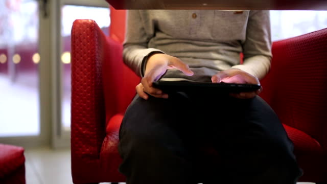 Boy uses the digital tablet under the table video