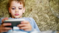 boy using his smart phone video