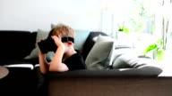 Boy Using Virtual Reality Glasses video