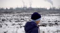 Boy walking on frozen road video