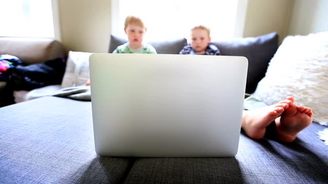 boy watching cartoons on laptop video