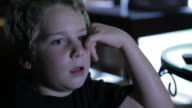 Boy watching TV. video