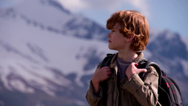 Boy with a Backpack in the Mountains video