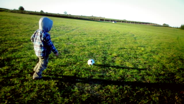 Boy with soccer ball video