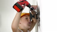 Boy working with electric screwdriver video