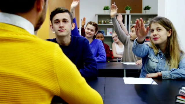 Boys and girls in class ready to give answer video