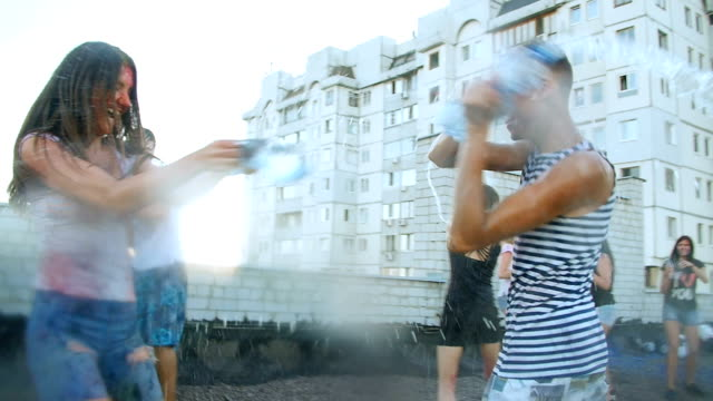 boys and girls pouring bottled water on people - young people fun video