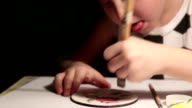 Boy's diligently hand-painting a coaster video