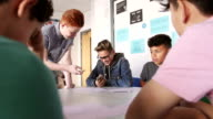 Boys Enjoying School Work Together video