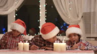 Boys in Santa hats. video