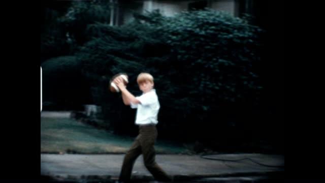 Boys Playing Football 1960's video