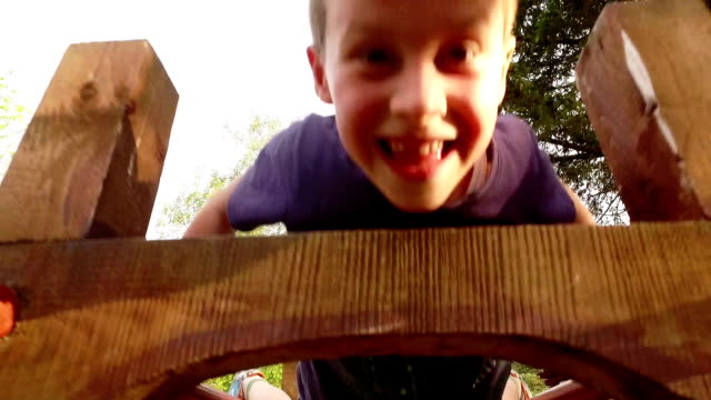 Boys playing in the park. Slow motion. video