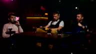 Boys smoking hookah in the caffee. Slow motion video