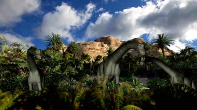 Brachiosaurus against timelapse clouds, seamless loop video