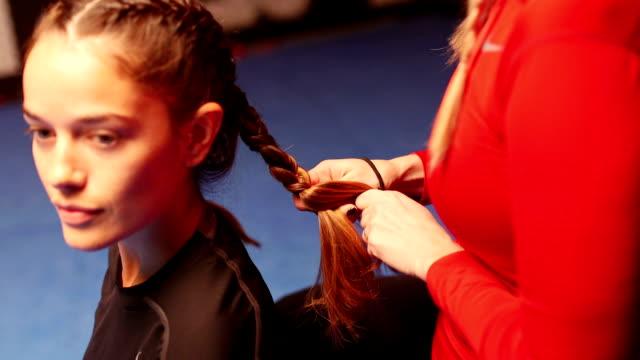 Braiding Hair before Training video