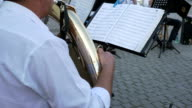 Brass Player Follows Music Sheets video