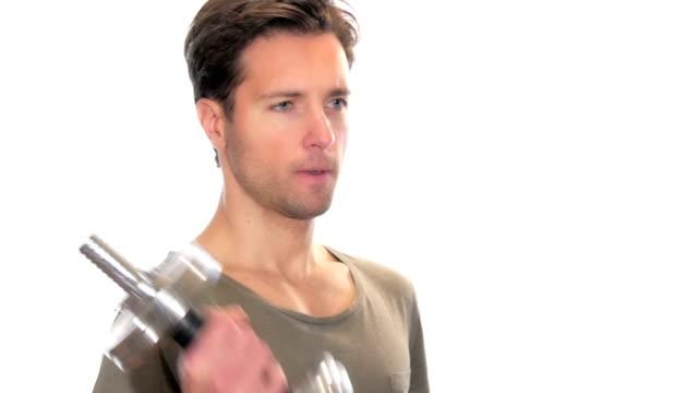 Brawny boy doing workout over white video