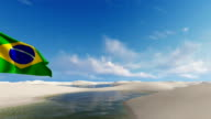 Brazil flag against white sand dunes and water lagoons background video