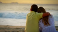 Brazilian couple embrace and look out over the ocean video