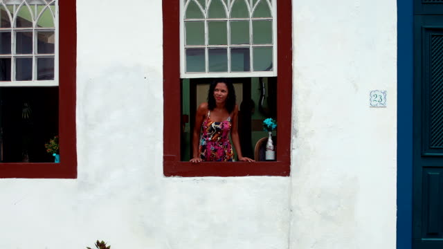 Brazilian girl looking out the window video