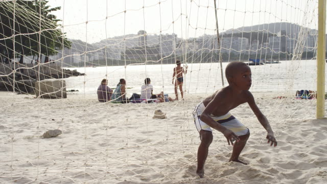 Brazilian kid attempts to block a soccer goal video