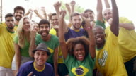 Brazilian Soccer Fans Pose and Cheer video