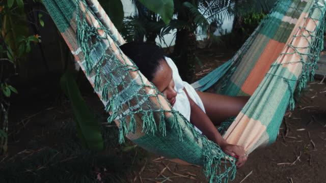 Brazilian woman sleeping on hammock video